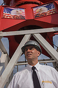 Investigative Engineering Services, Assistant Commissioner Tim Lynch and American crane while inspecting a new construction site in Manhattan, New York City.