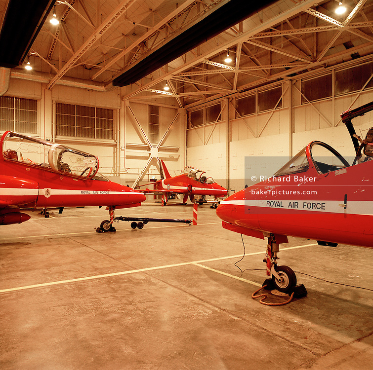 BAE Systems Hawks belonging to the elite 'Red Arrows', Britain's prestigious Royal Air Force aerobatic team, forms part of the team's highly-skilled group of support ground crew who outnumber the pilots 8:1. The team's aircraft are in some cases 25 years old and their airframes require constant attention, with frequent overhauls needed. In these shelters were housed the Lancaster bombers 617 Dambusters squadron who attacked the damns of the German Ruhr valley on 16th May 1943 using the Bouncing Bomb. The Red Arrows nearby offices as their administrative nerve-centre for the 90-plus displays they perform a year. .