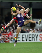 Cameron Sutcliffe of the Dockers and Daniel Hannebery of the Swans contest a mark during the 2013 AFL round 08 match between the Sydney Swans and the Fremantle Dockers at the SCG, Sydney on May 18, 2013. (Photo: Craig Golding/AFL Media)