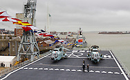 Helicopters on the flight deck aboard the Chinese Naval assault ship Chang Bai Shan at Portsmouth Royal Navy Base today. The ship is involved in the first visit by the Chinese Navy to the UK since 2007 and the largest ever. She is accompanied by the frigate Yun Cheng (in the background) and the replenishment ship Chaohu. The ships arrived in Portsmouth 24 hours early due to the expected bad weather. The Royal Navy statement stated that the five day formal visit is aimed at enhancing military understanding between the UK and China. Picture date Monday 12th January, 2015.<br /> Picture by Christopher Ison. Contact +447544 044177 chris@christopherison.com