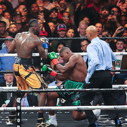 Deontay Wilder (R) knocks out Luis Ortiz during the WBC Heavyweight Championship boxing match at Barclays Center on Saturday, March 3, 2018 in Brooklyn, New York. Wilder would win the bout by knockout in the tenth round to retain the title and move to 40-0. (Alex Menendez via AP)
