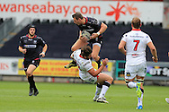 Dan Biggar of the Ospreys collides with Stuart McCloskey of Ulster.  Guinness Pro12 rugby match, Ospreys v Ulster Rugby at the Liberty Stadium in Swansea, South Wales on Saturday 7th May 2016.<br /> pic by  Andrew Orchard, Andrew Orchard sports photography.