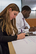 Purchase, NY – 31 October 2014. Ossining High School's Adriana Sallucci with case notes. With her is Morgan Stanley facilitator Nick Parris. The Business Skills Olympics was founded by the African American Men of Westchester, is sponsored and facilitated by Morgan Stanley, and is open to high school teams in Westchester County.