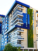 Patrick Blanc, a French botanist, has created his tallest vertical garden at a residential development in Sydney. The garden wall uses 4,528 native Australian plants that are fed by a grey-water dripper-irrigation system..Vertical gardens can offer a reduction in energy consumption through thermal insulation & cut down on greenhouse gas emissions.