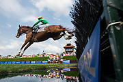 April 29, 2017, 22nd annual Queen's Cup Steeplechase. HENRY SAN and jockey Darren Nagle jump the water jump in the $20,000 Allowance Timber race.