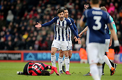 """West Bromwich Albion's Claudio Yacob appeals after a challenge on AFC Bournemouth's Adam Smith (left) during the Premier League match at the Vitality Stadium, Bournemouth. PRESS ASSOCIATION Photo. Picture date: Saturday March 17, 2018. See PA story SOCCER Bournemouth. Photo credit should read: Mark Kerton/PA Wire. RESTRICTIONS: EDITORIAL USE ONLY No use with unauthorised audio, video, data, fixture lists, club/league logos or """"live"""" services. Online in-match use limited to 75 images, no video emulation. No use in betting, games or single club/league/player publications."""