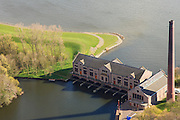 Nederland, Friesland, Gemeente Lemsterland, 16-04-2012; Lemmer, ir. D.F. Woudagemaal. Het stoomgemaal staat op de Unesco Werelderfgoedlijst en is het grootste nog in bedrijf zijnde stoomgemaal ter wereld. Bij extreem hoge waterstand doet het gemaal nog dienst en helpt om de waterstand van het Friese boezem op peil te houden. Sinds 1967 is het gemaal oliegestookt. ..Lemmer, ir D.F. Woudagemaal. The steam pumping station features on the UNESCO World Heritage List and is the largest pumping station still in operation worldwide. At extreme high water, the station is still in service and helps to maintain the proper water level of the Friesian boezemwater. Since 1967, the pumping station is oil fired..luchtfoto (toeslag), aerial photo (additional fee required).foto/photo Siebe Swart