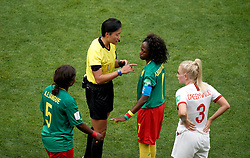 Match referee Qin Liang speaks with Cameroon's Gaelle Enganamouit (second right) after Ajara Nchout's goal is ruled out for offside by VAR during the FIFA Women's World Cup, round of Sixteen match at State du Hainaut, Valenciennes.