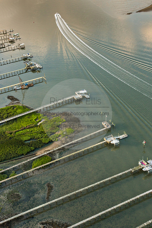 Aerial view of a boat in the harbor in Charleston, SC.