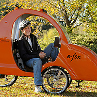 Jesse Stephenson, developer of the e-fox, poses for a photograph with the e-fox, a electric assisted, human powered vehicle, at NuWay2Commute on Monday, Nov. 4, 2013 in Wilmington, N.C. Photo By Mike Spencer/StarNews