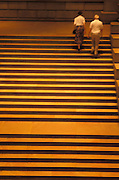 Elderly couple walking up stairs