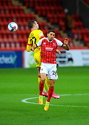 Rory Holden of Walsall and Liam Sercombe of Cheltenham Town compete for the highball- Mandatory by-line: Nizaam Jones/JMP - 21/11/2020 - FOOTBALL - Jonny-Rocks Stadium - Cheltenham, England - Cheltenham Town v Walsall - Sky Bet League Two