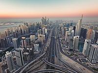 Aerial view of highway crossing Dubai at sunset, United Arab Emirates.