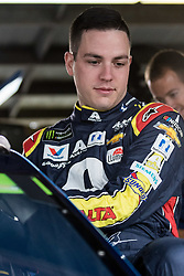 October 5, 2018 - Dover, DE, U.S. - DOVER, DE - OCTOBER 05: Alex Bowman climbs into his #88 Axalta Chevrolet getting ready for Friday's practice for the Monster Energy NASCAR Cup Series Gander Outdoors 400 on October 05, 2018, at Dover International Speedway in Dover, DE. (Photo by David Hahn/Icon Sportswire) (Credit Image: © David Hahn/Icon SMI via ZUMA Press)