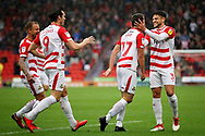 Doncaster Rovers midfielder Matty Blair celebrates with Doncaster Rovers defender Danny Andrew (3) after his goal during the EFL Sky Bet League 1 match between Doncaster Rovers and Luton Town at the Keepmoat Stadium, Doncaster, England on 8 September 2018.