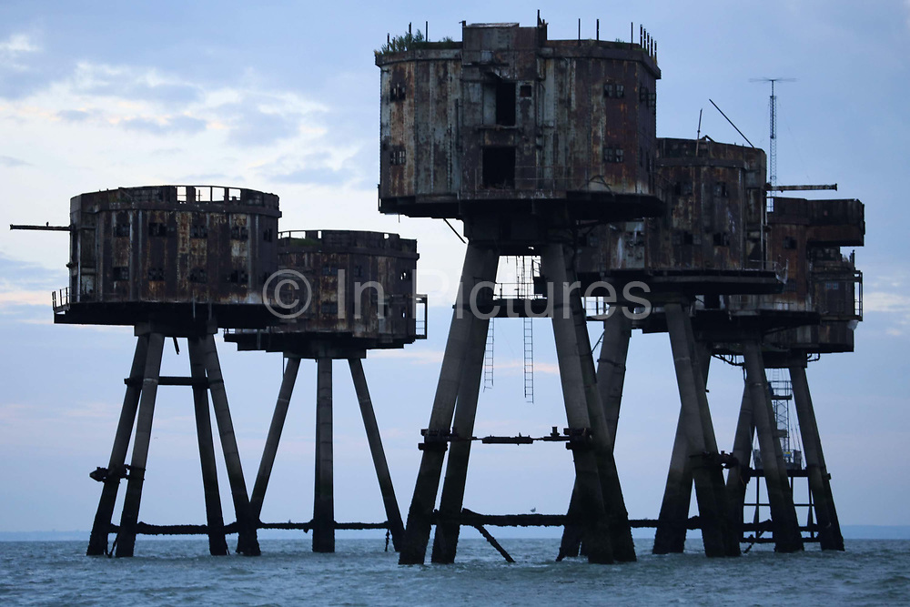 Sunrise in the Thames Estuary September 21st 2017, Thames Estuary, Kent, United Kingdom.The Red Sands Towers are remains of WW2 forward defences and were maned by gunners to shoot down German bombers coming in to bomb London.