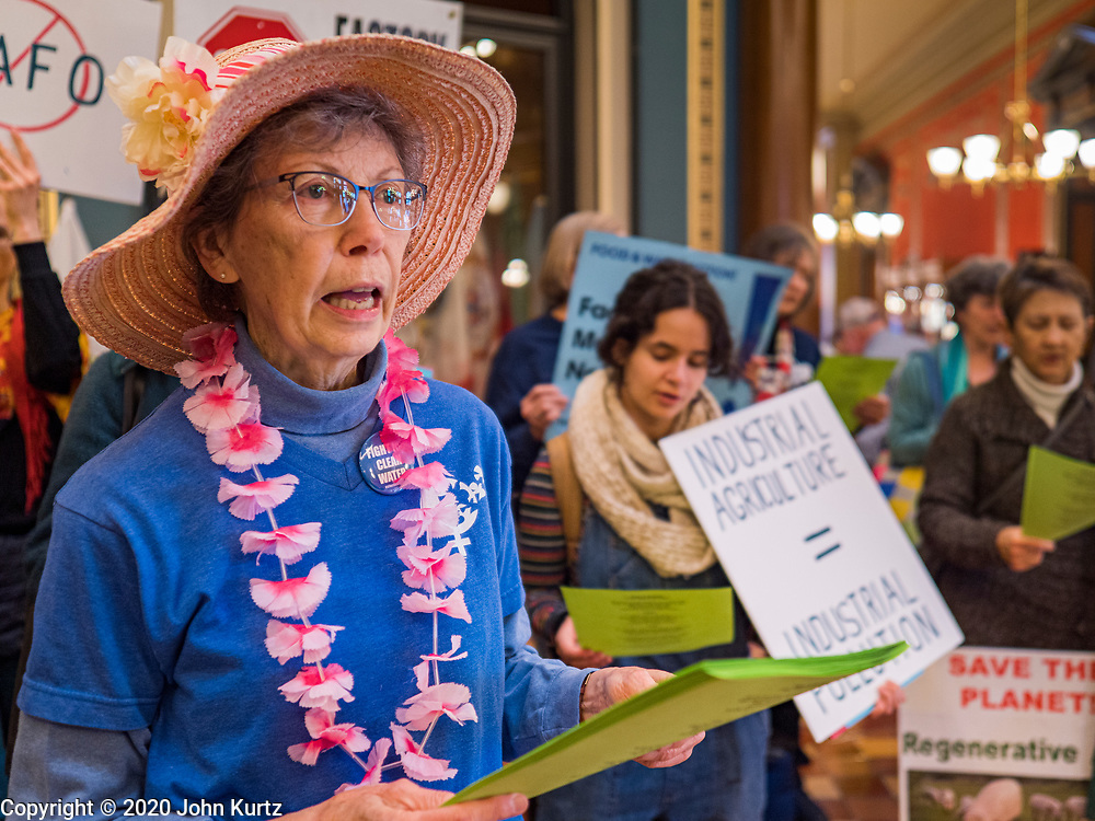 """23 JANUARY 2020 - DES MOINES, IOWA: MARY ANN KOCH, from Urbandale, a suburb of Des Moines, a member of the """"Raging Grannies,"""" sings about the dangers of factory farms during a rally in the Iowa State Capitol against factory farms. About 75 people, including farmers, environmental activists, and supporters of family farms, came to a protest in the rotunda of the state capitol in Des Moines. They are trying to pressure Iowa lawmakers to pass a moratorium against new factory farm construction in Iowa.       PHOTO BY JACK KURTZ"""