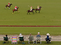 Town of Wallkill, NY - Spectators in lawn chairs watch a polo match at the Blue Sky Polo Club on Aug. 19, 2007.
