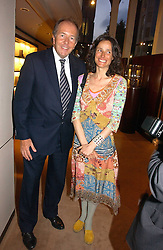 LORD BRUCE DUNDAS and the MARCHIONESS OF WORCESTER at a party to celebrate 100 years of Chinese Cinema hosted by Shangri-la Hotels and Tartan Films at Asprey, New Bond Street, London on 25th April 2006.<br />