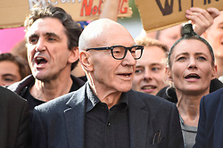 © Licensed to London News Pictures. 19/10/2019. LONDON, UK.  Actor Sir Patrick Stewart (C) takes part in the People's Vote March to demand a final say on Brexit.  Protesters carry banners and signs and are marching from Park Lane to a rally in Parliament Square.  Photo credit: Stephen Chung/LNP