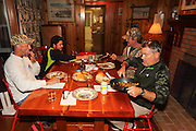 Enjoying a meal at a historic duck camp on the Delta Marsh in Manitoba, Canada