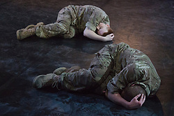 "© Licensed to London News Pictures. 07/05/2015. London, England. The company performs ""Firefight"". The Rosie Kay Dance Company perform ""5 Soldiers: The Body is the Frontline"" at The Rifles Officers' Club in Mayfair, London from 7 to 9 May 2015 before continuing a UK tour. 5 Soldiers gives an intimate view of the training that provides soldiers for combat and warfare and how the experience affects those that put their life on the line. Dancers: Duncan Anderson, Shelley Eva Haden, Chester Hayes, Sean Marcs and Oliver Russell. Choreographed and directed by Rosie Kay.  Photo credit: Bettina Strenske/LNP"
