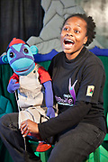 Kitty Moepang singing with Mac the Monkey during rehearsals for 'No Monkey Business', an AREPP: Theatre for Life production providing interactive social life skills education to schoolchildren through theatre productions. They are based in Johannesburg, South Africa and are about to go on tour for 3 months doing performances everyday at schools across the country.