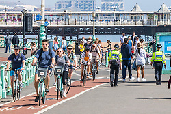 © Licensed to London News Pictures.08/05/2020. Brighton, UK. Police patrol the beach and promenade in Brighton and Hove on the May Bank Holiday Friday as the country remains under the Coronavirus lockdown. Photo credit: Hugo Michiels/LNP