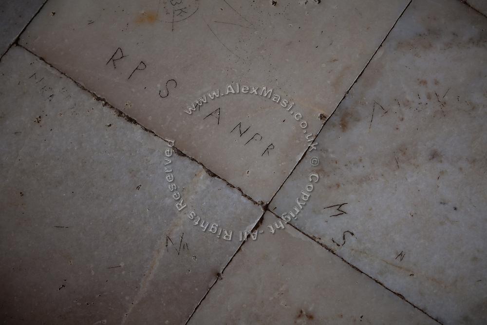 A graffiti is seen on the Taj Mahal's Markana marble, inside the main tomb area, in Agra.