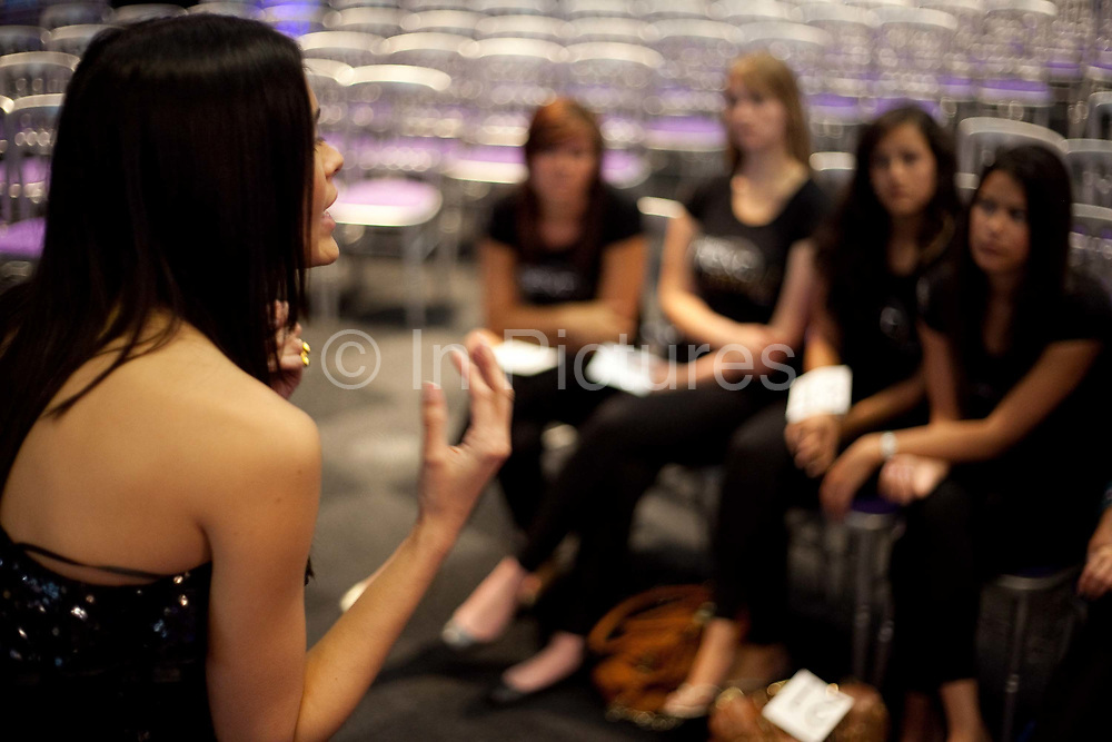 Contestants are given cat walk tips from a professional model from Select Model Agency. Fifty finalists voted for by tens of thousands via face book made it to the London final. They were put through their paces, had modelling lessons and made up by top professionals. In the evening friends and Next customer competition winners attended a party and fashion show hosted by Alesha Dixon and Paul Sculfor where the eventual winners Dan Clarke, 26, and Kiren Modi,20, were decided upon by industry leaders.