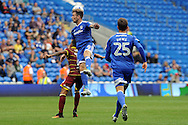 Cardiff City's Joe Ralls (c) beats QPR's Tjaronn Chery to a header. EFL Skybet championship match, Cardiff city v Queens Park Rangers at the Cardiff city stadium in Cardiff, South Wales on Sunday 14th August 2016.<br /> pic by Carl Robertson, Andrew Orchard sports photography.