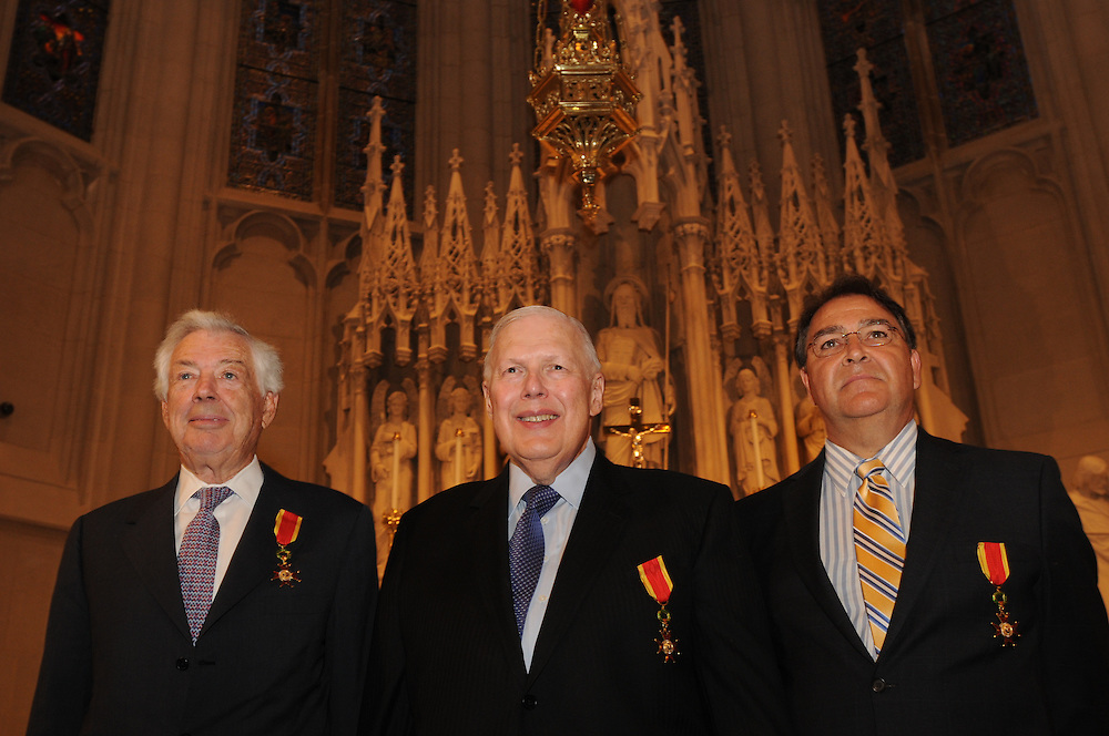 Chicago Archbishop Francis Cardinal George presents the Certificates and Insignia of the Equestrian Order of St. Gregory the Great during a Morning Prayer at the St. James Chapel at the Archbishop Quigley Center, June 23, 2012. The Papal honor is recommended by a local Bishop to recognize meritorious service to the church. The honorees include Archdiocese of Chicago Chancellor Jimmy Lago, Finance Council Vice Chair James Denny, and the Cardinal's legal counsel James Serritella. l Brian J. Morowczynski~ViaPhotos<br /> <br /> For use in a single edition of Catholic New World Publications, Archdiocese of Chicago. Further use and/or distribution may be negotiated separately. <br /> <br /> Contact ViaPhotos at 708-602-0449 or email brian@viaphotos.com.