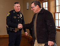 Gilford Police Chief Anthony Bean-Burpee is joined by John Larrere for Coffee with the Chief at Gilford Library on Monday morning.   (Karen Bobotas/for the Laconia Daily Sun)