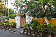 A Colonial house with many plants and flowers outside, Pondicherry, India. Pondicherry now Puducherry is a Union Territory of India and was a French territory until 1954 legally on 16 August 1962. The French Quarter of the town retains a strong French influence in terms of architecture and culture.