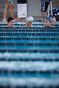 Swimmers stay warm and relax during the swim meet against Newark Memorial at Milpitas High School in Milpitas, California, on February 27, 2015. (Stan Olszewski/SOSKIphoto)