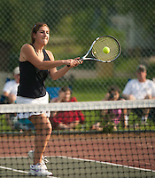 Emily Zbehlik returns the ball during her singles match for the NHIAA State Championship final in girls tennis at PSU Friday afternoon.  (Karen Bobotas/for the Concord Monitor)