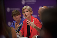 20150903, Thursday, July 15, 2015; North Easton, MA, USA; Stonehill College President Rev. John Denning, C.S.C. and professor Peter N. Ubertaccio welcomed the senator to campus before the program began.<br /> <br /> Stonehill College's Martin Institute for Law & Society welcomed Massachusetts United States Senator Elizabeth Warren for a panel discussion surrounding educational financing and the crisis of college student debt on Thursday afternoon inside the Martin Institute auditorium. <br /> <br /> background: <br /> <br /> Rev. John Denning, C.S.C. became the tenth president in Stonehill's 65-year history. Formerly the Vice President for Student Affairs at the College, Fr. Denning succeeded Rev. Mark T. Cregan '78, C.S.C. who stepped down in June 2013 after 13 successful years of leading the College.<br /> <br /> Peter N. Ubertaccio is the Stonehill College  associate Dean for Interdisciplinary Programs<br /> Associate Professor of Political Science<br /> Director, Martin Institute for Law & Society<br /> <br /> ( lightchaser photography © 2015 )