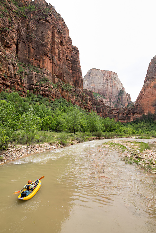 Paddling an inflatable kayak on the North Fork Virgin River in Zion National Park, Utah.