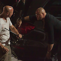 US actor Bruce Willis (in white T-shirt) participates a rehearsal of a fight schene on set during a shooting of their next movie fifth in the Die Hard series titled Good Day to Die Hard in Budapest, Hungary on July 11, 2012. ATTILA VOLGYI