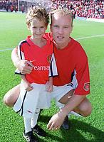Dennis Bergkamp with the Arsenal mascot. Arsenal 1:0 Manchester United, F.A.Carling Premiership, 1/10/2000. Credit Colorsport / Stuart MacFarlane.