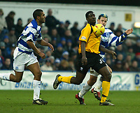 Photo. Chris Ratcliffe<br /> QPR v Rushden & Diamonds. Nationwide Division 2. 03/01/2004<br /> Onandi Lowe for Rushden and Marc Bircham and Clarke Carlisle of QPR chase the ball