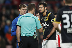 (L-R) goalkeeper Nigel Bertrams of NAC Breda, referee Pol van Boekel, Pablo Mari Villar of NAC Breda during the Dutch Eredivisie match between PSV Eindhoven and NAC Breda at the Phillips stadium on March 31, 2018 in Eindhoven, The Netherlands