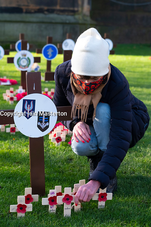 Edinburgh, Scotland, UK. 5 November 2020.  Members of the public pay their respects at garden of remembrance in Princes Street Gardens. Formal ceremonies have been cancelled because of Covid-19 on Remembrance Day. Iain Masterton/Alamy Live News