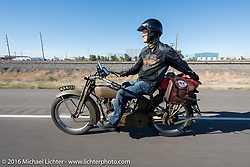 Harry Verkuil of Scotland punps gas from his fender mounted spare tank as he approaches Pueblo, Colorado on his 1916 Model F class-3 Harley-Davidson during the during the Motorcycle Cannonball Race of the Century. Stage-9 Dodge City, KS to Pueblo, CO. USA. Monday September 19, 2016. Photography ©2016 Michael Lichter