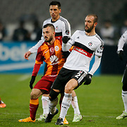 Besiktas's Serdar Kurtulus (2ndR) and Galatasaray's Emre Colak (2ndL) during their Turkish superleague soccer match Besiktas between Galatasaray at Ataturk Olimpiyat Stadium in Istanbul Turkey on Sunday 04 January 2015. Photo by Aykut AKICI/TURKPIX