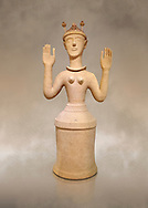 """Minoan Postpalatial terracotta  """"Poppy goddess: statue with raised arms and poppy seed crown,  Karphi Sanctuary 1300-1200 BC, Heraklion Archaeological Museum. <br /> <br /> The """"Poppy Goddess"""" statuye is crowned with opium poppy seed heads. As opium is a hallucinogen that also sedates and has healing properties, experts assume this was the goddess of pain relief and healing/ During this period both Minoan and Mycenaean graves were found in Karphi snctuary so these cult gods are attributable to both cultures .<br /> <br /> If you prefer to buy from our ALAMY PHOTO LIBRARY  Collection visit : https://www.alamy.com/portfolio/paul-williams-funkystock/minoan-art-artefacts.html . Type -   Heraklion   - into the LOWER SEARCH WITHIN GALLERY box. Refine search by adding background colour, place, museum etc<br /> <br /> Visit our MINOAN ART PHOTO COLLECTIONS for more photos to download  as wall art prints https://funkystock.photoshelter.com/gallery-collection/Ancient-Minoans-Art-Artefacts-Antiquities-Historic-Places-Pictures-Images-of/C0000ricT2SU_M9w"""