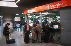 People queuing for tickets at Atocha railway station; Madrid,