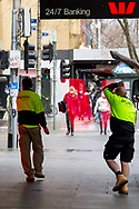 Two men carry a pane of glass in the CBD during COVID-19 in Melbourne, Australia. Victoria has recorded 14 COVID related deaths including a 20 year old, marking the youngest to die from Coronavirus in Australia, and an additional 372 new cases overnight. (Photo by Dave Hewison/Speed Media)