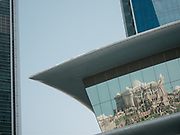 Architectural reflection on the Etihad Towers.