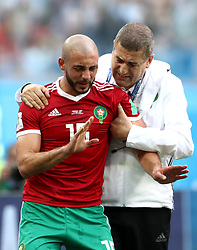 Morocco's Nordin Amrabat protests the decision to be substituted after suffering an injury in a collision